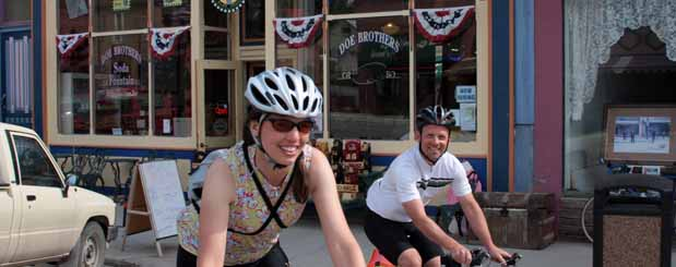 Two cyclists leaving the local soda fountain