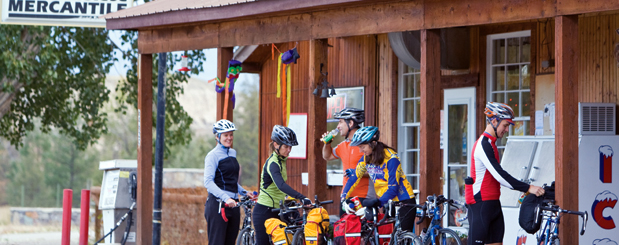 Cyclists outside the Moise Mercantile in Montana