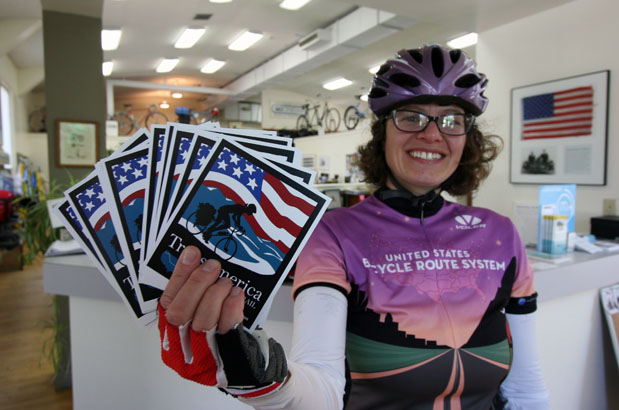 Heidi Bierle displays route decals for the TransAmerica Trail, or U.S. Bike Route 76