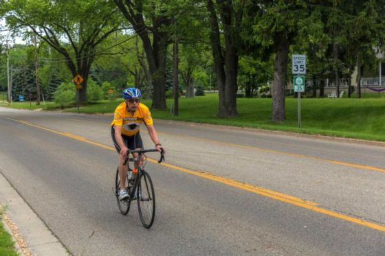 Us bicycle route 35 tart trails inc kerry irons rides past a usbr 35 sign in his hometown of holland mi sciox Image collections