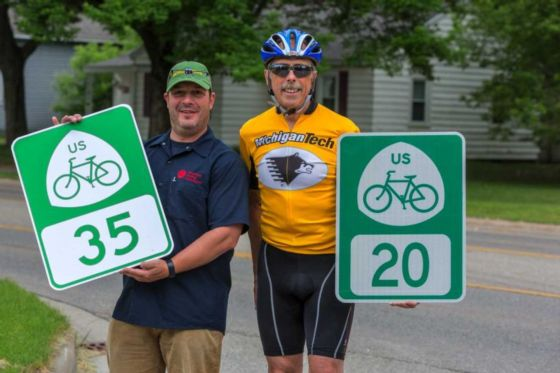 Us bicycle route 35 tart trails inc michigan usbrs volunteer coordinator kerry irons right shows off the usbr 20 and 35 signs with adventure cycling staffer mike deme left sciox Image collections