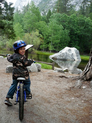 A young bicyclist in Yosemite National Park. Photo by Lisa McKinney.