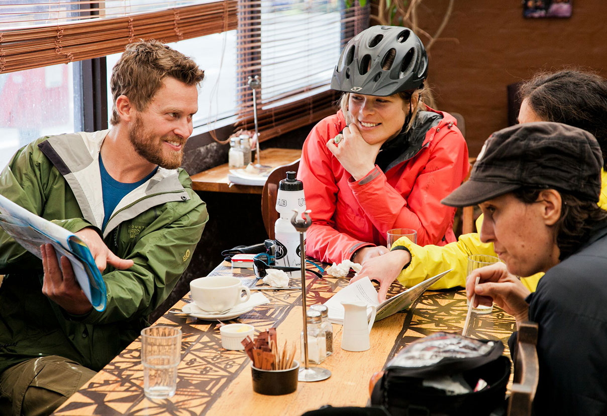 Group of cyclists enjoying down time at restaurant