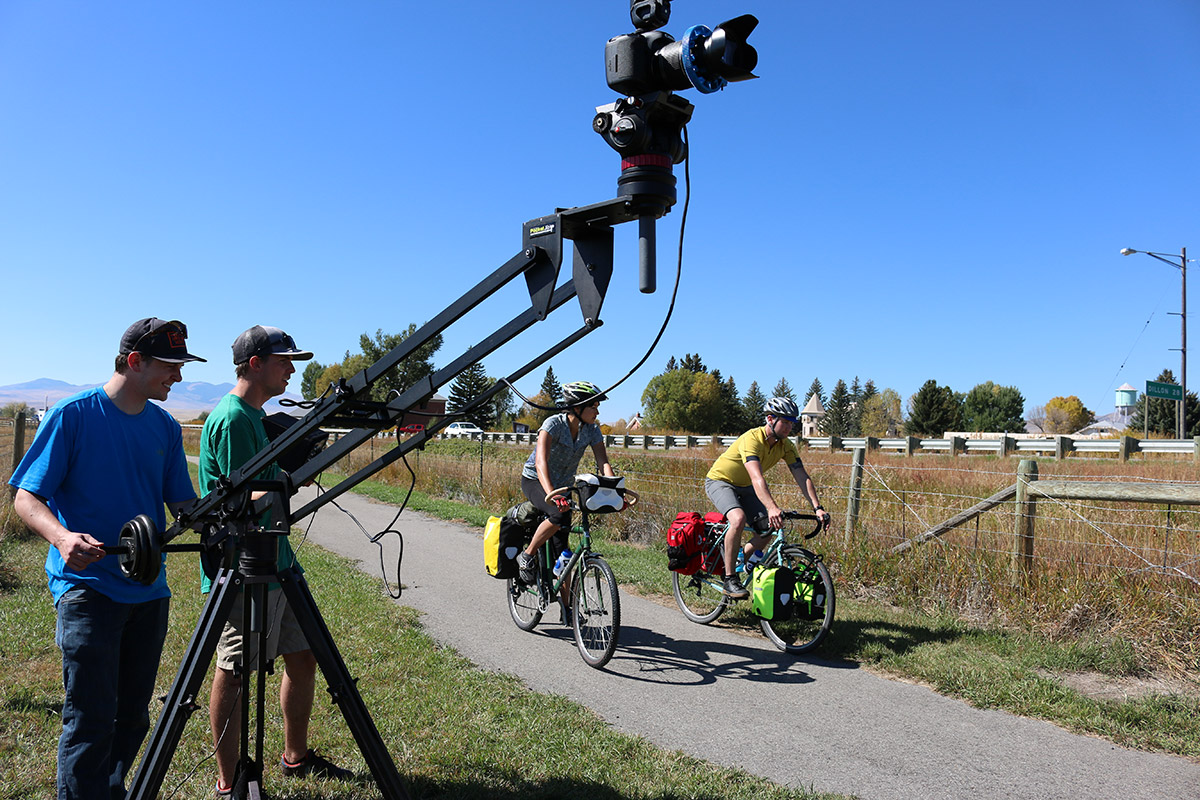 Camera crew filming cyclists on a bike path