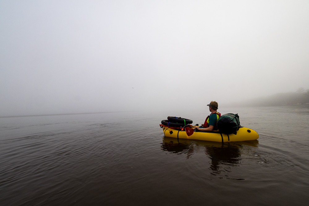 Bike rafting through the fog to the island.