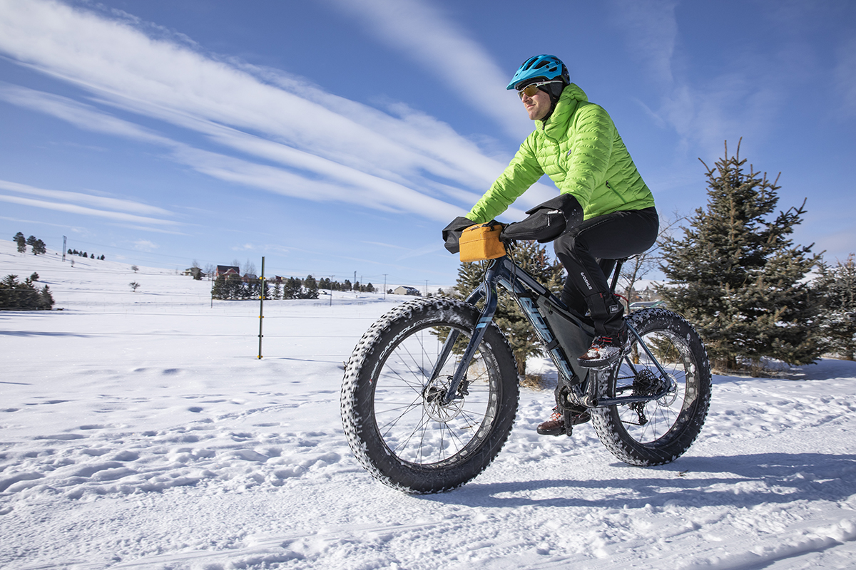 Riding a fat bike on snow.