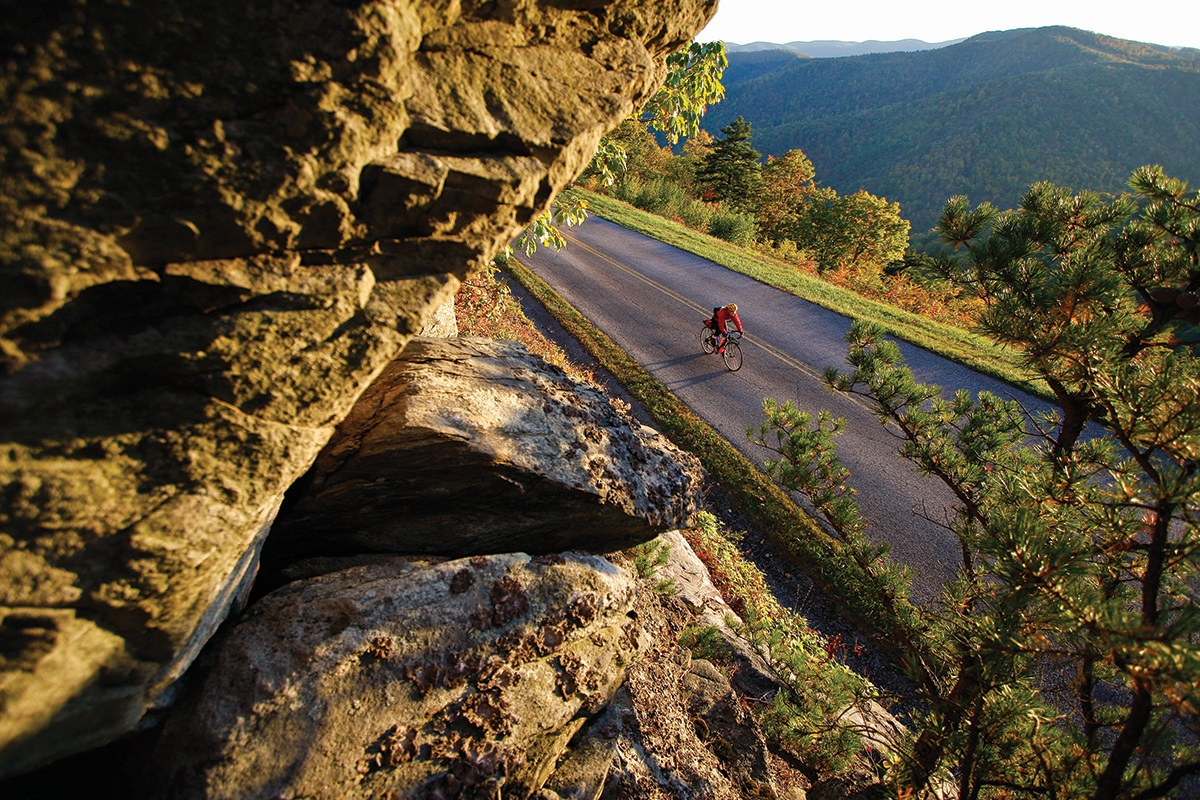 Dennis Coello incorporates landscape into his adventure cycling photography.