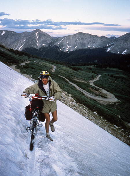 Bike touring in the mountains sometimes means a bit of hiking, and a bit of snow.