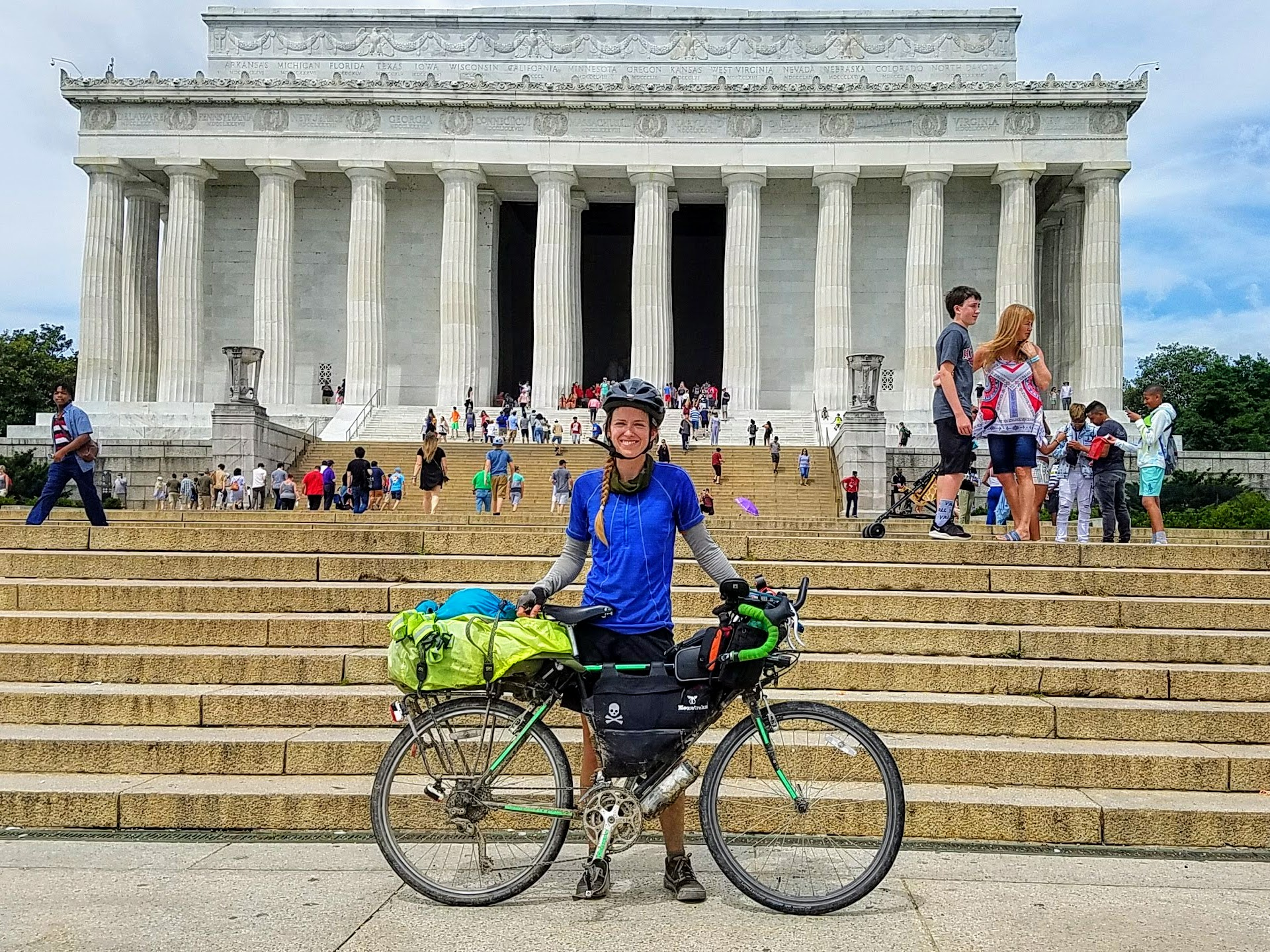 Alissa Bell and her bicycle in front of the Lincoln Memorial