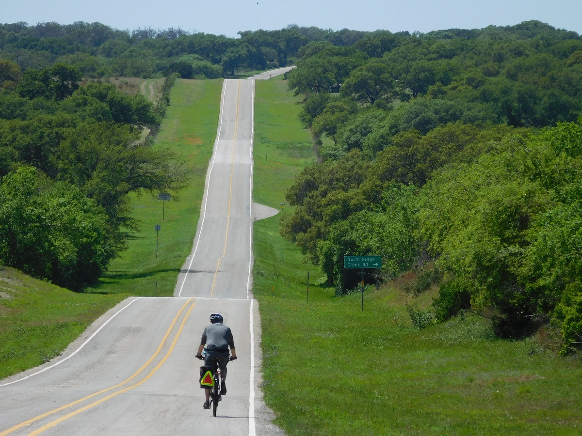 A cyclist rides the hills on the Texas Hill Country Loop