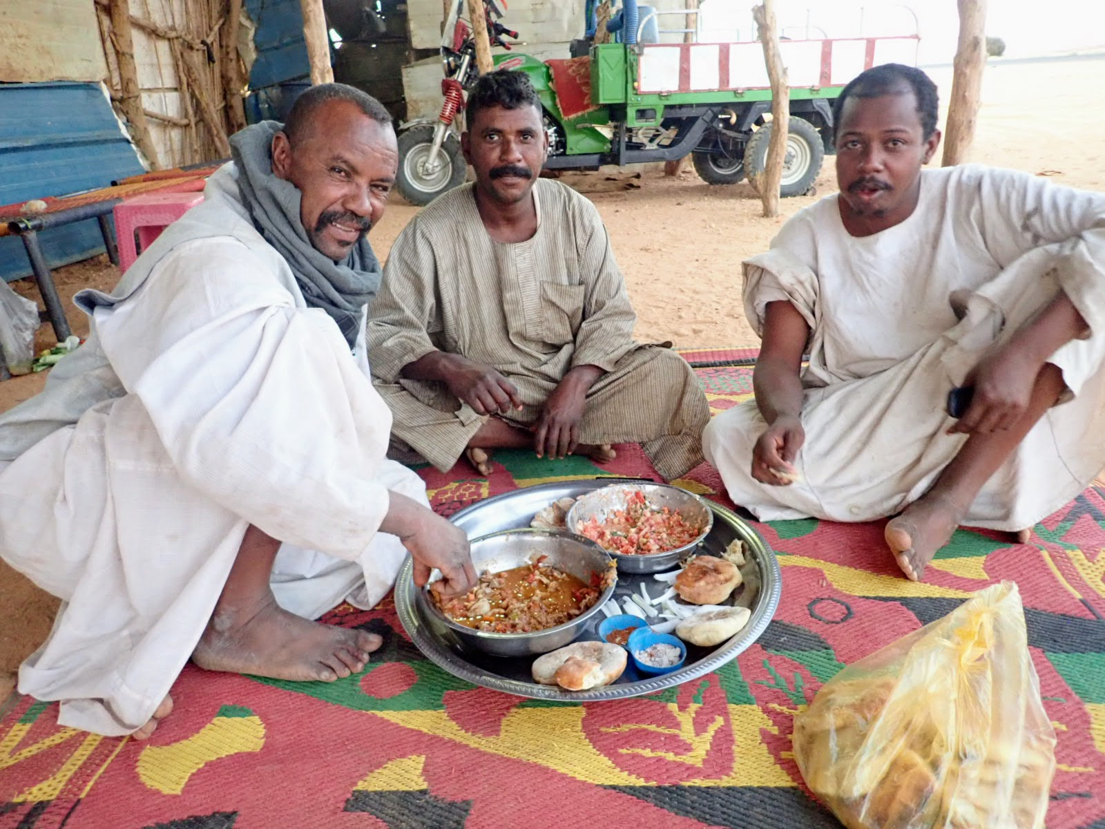 Sudanese men sharing food