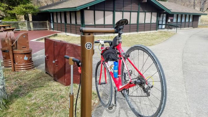 Bike travel in National Parks: A repair stand and bike pump provide emergency bike maintenance along Skyline Drive.