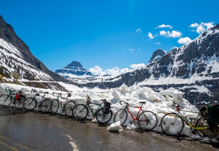 Bike travel in National Parks: A car-free Going-to-the-Sun Road is the ride of a lifetime during Glacier Park's spring plowing.
