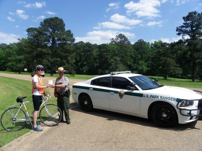Bike travel in National Parks: A bike light and high visibility vest giveaway makes cyclists more visible on the Natchez Trace.