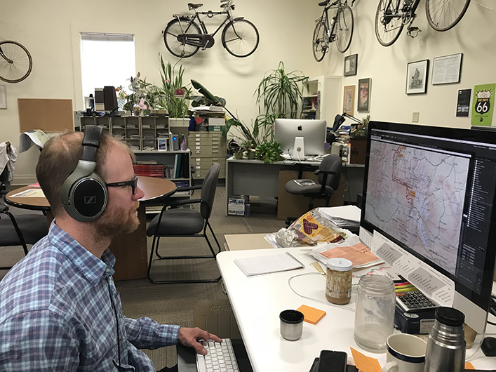 Cartographer Jamie Robertson working on Great Divide Mountain Bike Route map.