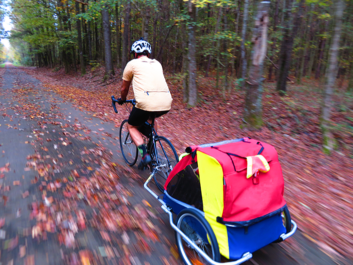 cycling rail trail with baby trailer