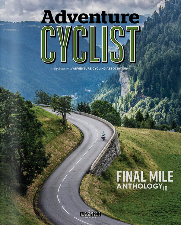 Adventure Cyclist magazine August cover